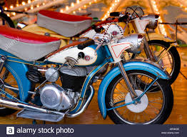 vintage small childrens size motorcycles on a merry go