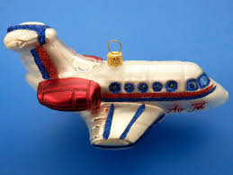 fair image of decorative white and blue airplane blown glass