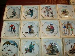 i a set of norman rockwell mini plates 66 in all all