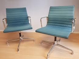 blue desk chairs ea 108 aluminum office chairs with petrol blue upholstery by
