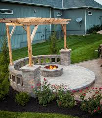 string lights fire pit with built in seating covered by a