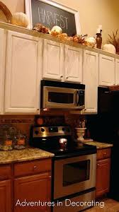 top of kitchen cabinet decorating ideas above the cabinet decor above kitchen cabinet decor ideas kitchen