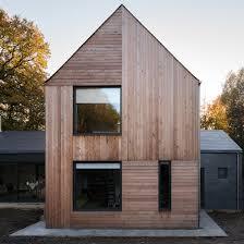 robert konieczny uses drawbridge to create ark like house on a