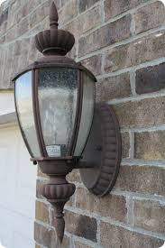 spray painting outdoor lights it works from thrifty decor