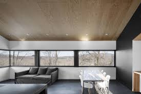 living room and dining room combined photo 3 of 11 in amazing cantilevered home in the mountains dwell