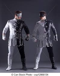 masquerade costumes beautiful men posing in masquerade costumes on gray stock