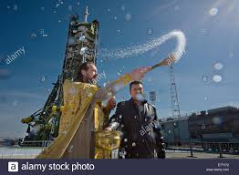 a russian orthodox priest blesses the soyuz rocket on the launch