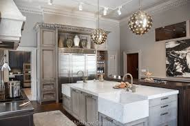 gray kitchen island is topped with white quartz countertop and