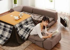 slay winter with a heated kotatsu table bed from japan inhabitat