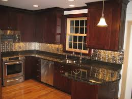 mahogany kitchen cabinets and with black granite countertop