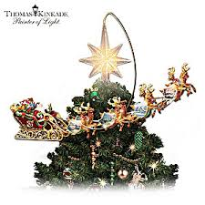 kinkade holidays in motion rotating illuminated tree topper