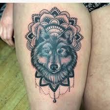 mandala wolf on thigh