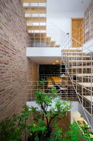block architects adds trellises and steel bar walls to vietnamese