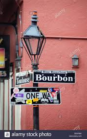 bourbon sign l or lantern and sign at the corner of toulouse and