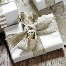 add texture to your gift wrapping by using burlap ribbon to a