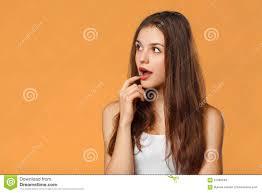 hair i woman s chin sideways surprised happy beautiful woman looking sideways in excitement on