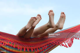 childrens feet in hammock stock photo getty images