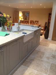large island unit with integrated dishwashers and belfast sink