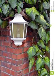 white lamp on brick wall stock photos image 30641793