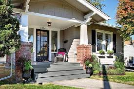 love this grey house with brick and porch curb appeal