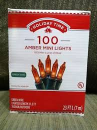 100 count mini lights holiday time 100 count amber mini light set green wire indoor