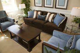 a brown leather sofa matches a dark wooden coffee table in front