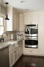 off white kitchen cabinets with stainless appliances off white kitchen with black appliances therobotechpage