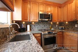 Traditional Kitchen Backsplash Kitchen Luxury Natural Oak Cabinets With Glass Mosaic Backsplash