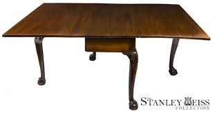 a robust chippendale dining room table with carved knees and claw