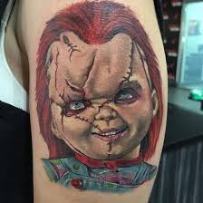colorful chucky tattoo by cecil porter