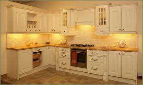 cherry wood saddle windham door thomasville kitchen cabinet cream