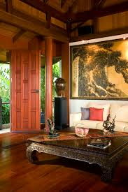 An Asian Style Living Room With A Tall Stained Wood Ceiling And - Thai style interior design