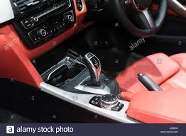 red luxury car interior with steering wheel shift lever and air