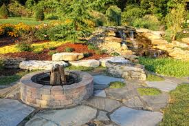 architecture backyard fire pit with stone pavers and boulders