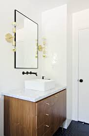 Gold Bathroom Fixtures by Sleek Bathroom Design With Glossy Wooden Vanity And Square Sink