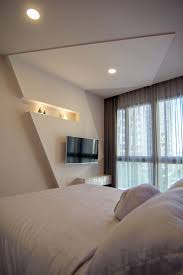 Tv Accent Wall by Bedroom Bedding And Bedroom Tv Unit Design With Window Treatments