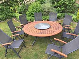 hartman teak garden table and 8x chairs with granite lazy susan