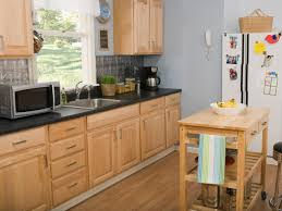 kitchen cabinet handles with hardwood floor and wooden table also