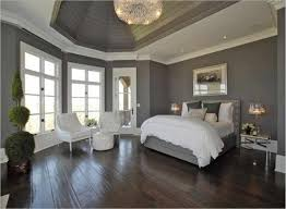 layout by white sofa on the black and beautiful master bedroom