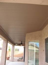 custom patio cover and porch addition with radius stucco beams