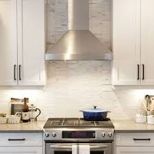 White Cabinets With Tile Marble Backsplash Stainless Steel Hood