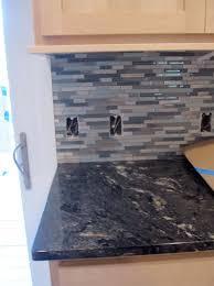 glass tile backsplash with black granite countertops home design