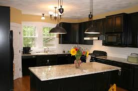 fine painted kitchen cabinets with black appliances mid tone