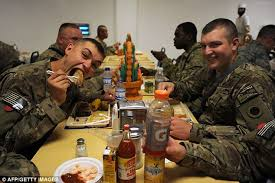 u s soldiers in afghanistan and iraq enjoy thanksgiving meal as