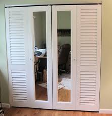 a combination of plantation louvered doors and mirror doors are