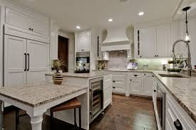 giallo ornamental white cabinets backsplash