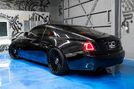 roll royce inside murdered out rolls royce wraith keeps the party on the inside