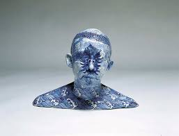china designs ah xian paints chinese decorative designs on porcelain busts