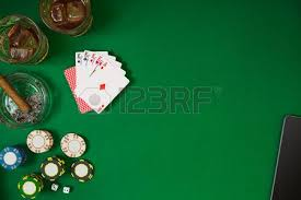 poker table top and chips set to playing poker with cards and chips on green table top