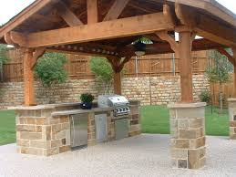 outdoor kitchen ideas green egg stone walls texture backsplash